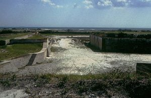 "The landward side of Fort Pickens has a dry ditch, with a counterscarp wall and glacis, which protected the main fort wall from direct cannon fire, and provided another position for infantry to defend the fort from (the ""covered way""). The ditch was previously much deeper than at present. The original depth can be visualized with the knowledge that the stairs leading to the covered way meet at the orignal level of the bottom of the ditch. The seaward side of Fort Pickens also had a dry ditch, which was filled sometime in the past."